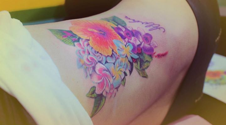 Flower's lovely tattoo by Candelaria Carballo