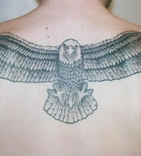 Flying black eagle men's back tattoo