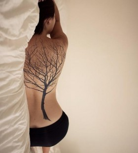 Full back girl's black tree tattoo