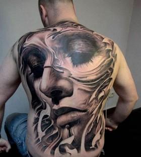 Full face men's back tattoo