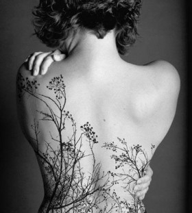 Full girl's back flower tattoo