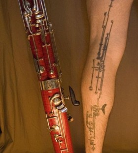 Full leg black clarinet tattoo