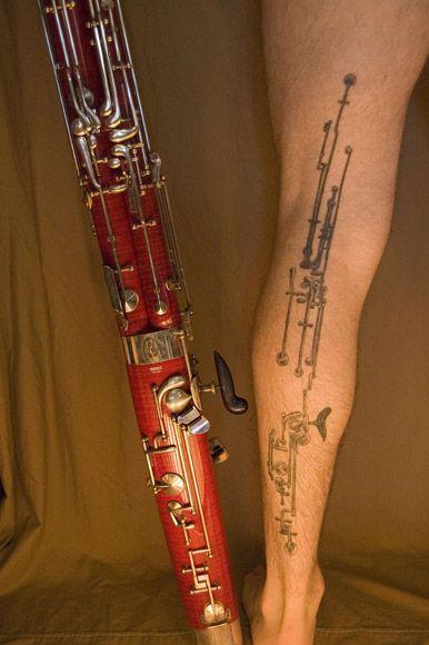 Full leg black clarinet tattoo