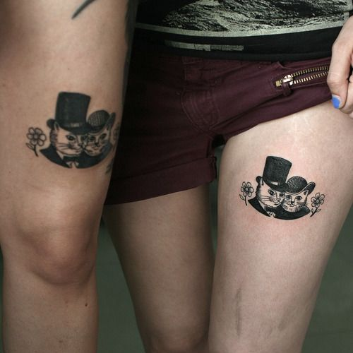 Funny cat's family picture tattoo
