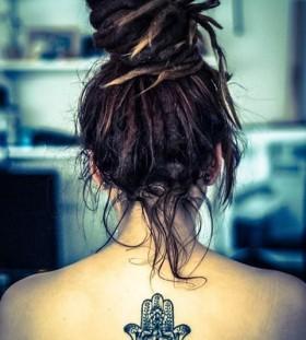 Girl's amazing hair and hamsa tattoo