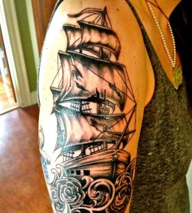 Girl's arm's ship tattoo