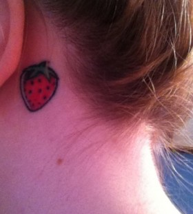 Girl's ear strawberry tattoo
