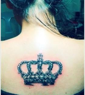 Girl's full back crown tattoo