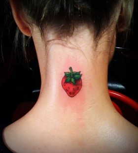 Girl's neck strawberry tattoo