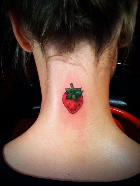 Girl's neck strawberry tattoo