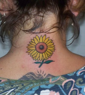 Girl's neck sunflower tattoo