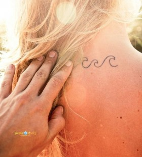 Girl's neck wave tattoo