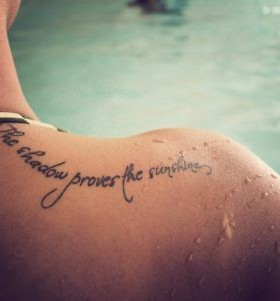 Girl's shoulder quote tattoo