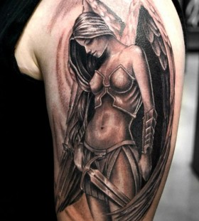 Girl's soldier angel tattoo