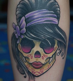 Girly hairstyle skull tattoo