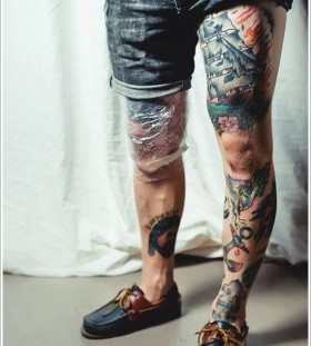Good looking ships and tattoo on men's legs