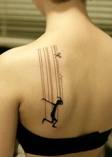 Gorgeous black dancing tattoo