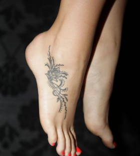 Gorgeous black lace foot tattoo