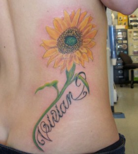 Gorgeous green sunflower tattoo