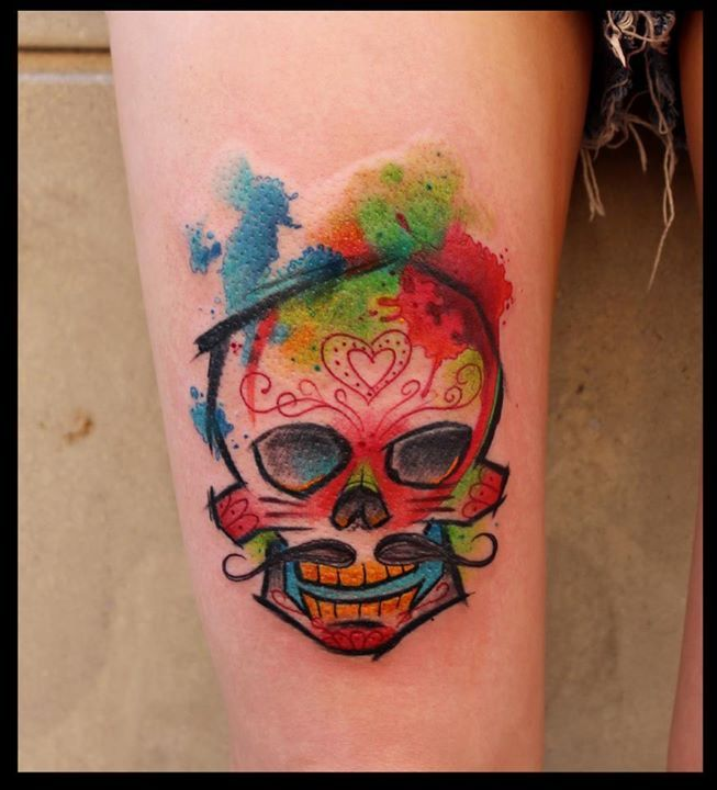 Gorgeous lovely watercolor skull tattoo