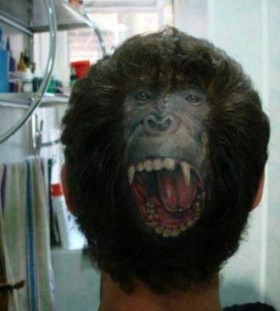 Gorgeous monkey tattoo on head