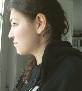 Gorgeous music style girl's ear tattoo