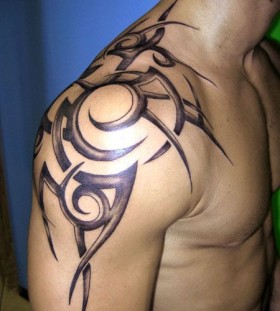 Gorgeous owals black men's shoulder tattoo