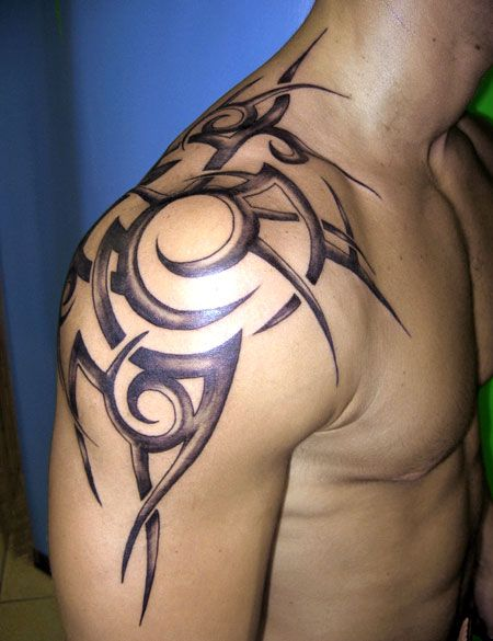 Gorgeous owals black men's shoulder tattoo