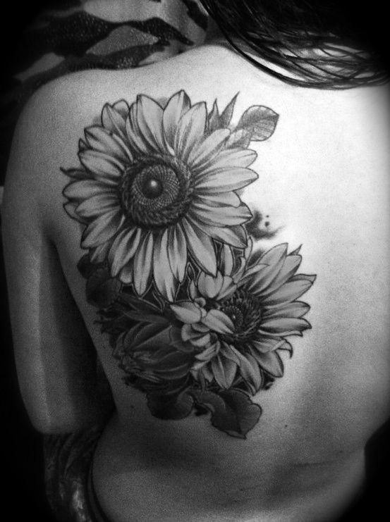 Gorgeous sunflower on back flower tattoo