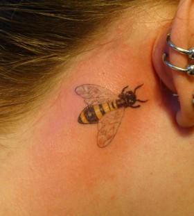 Great bee girl's ear tattoo