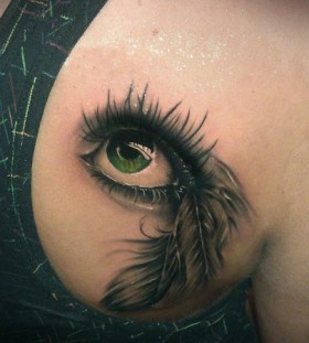 Green adorable eye tattoo