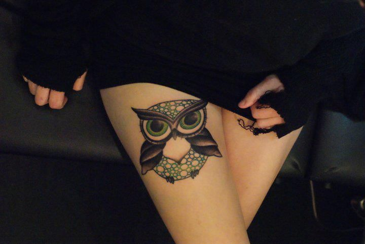 Green owl tattoo by Dodie