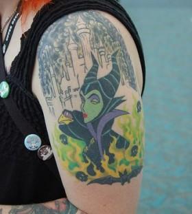 Green women's disney tattoo