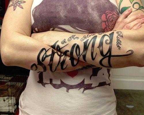Gun and roses men's arm tattoo