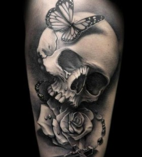 Gun and skull rose tattoo