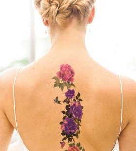 Hairstyle and back flower tattoo