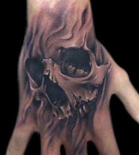 Hand and fingers skull tattoo
