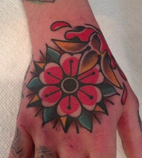 Hand's flower tattoo by Austin Maples
