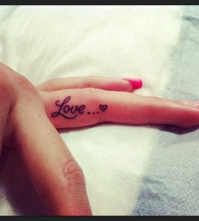 Heart and finger love tattoo