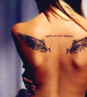 Hot fashion girl wing tattoo