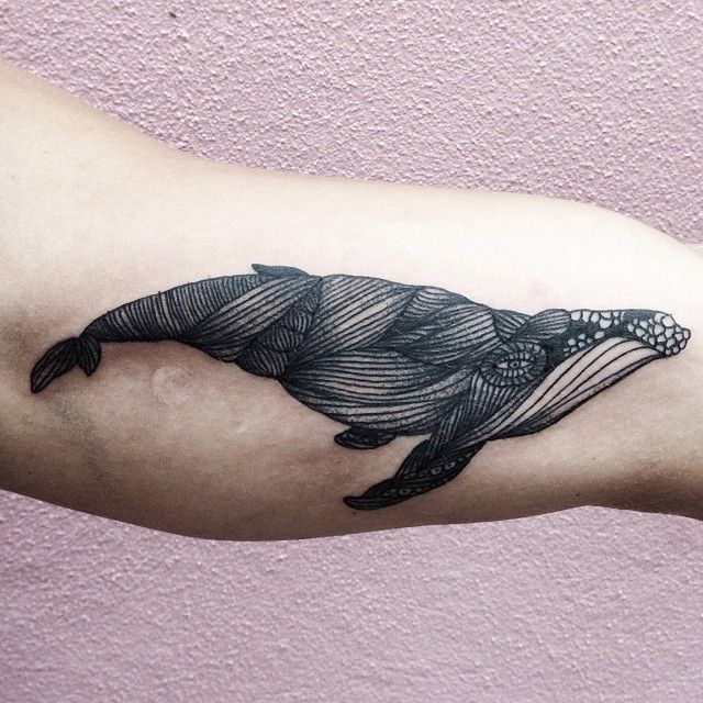 Huge black whale tattoo