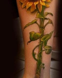Huge leg's sunflower tattoo