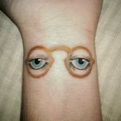 Light blue eye tattoo