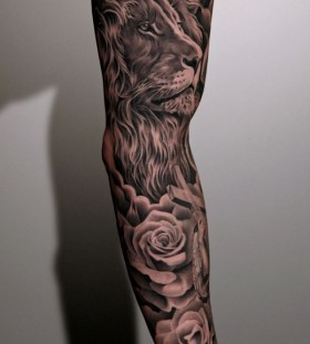 Lion and black rose tattoo