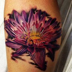 Looking great pink flower and bee tattoo on leg