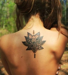 Lotus flowers girl's back tattoo