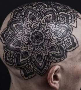Lovely black flower tattoo on head