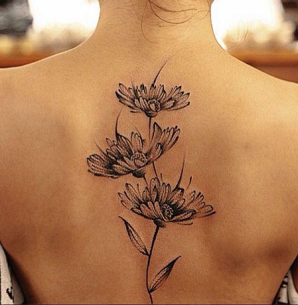 Lovely flowers back tattoo