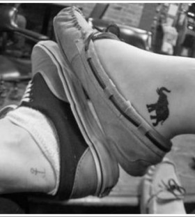 Lovely leg's black elephant tattoo