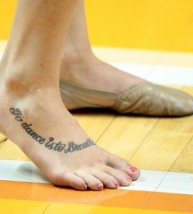 Lovely looking dancer tattoo